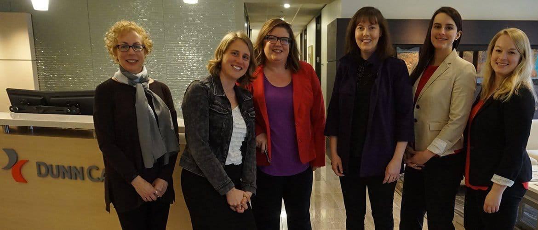 Dunn Carney's League of Attorney Women before an event.
