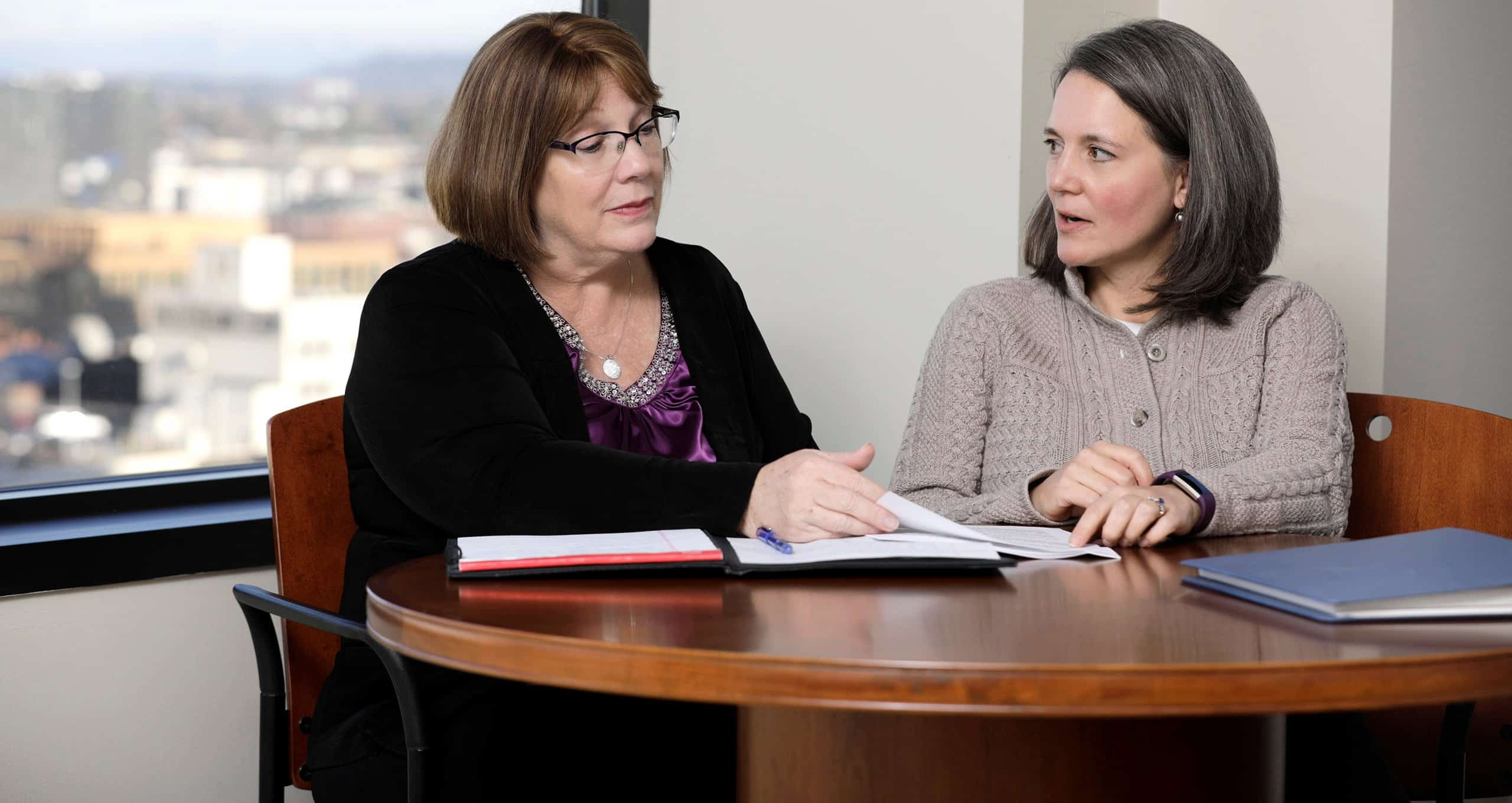 Portland attorneys Marsha Murray-Lusby and Heather Guthrie represent estate planning clients.